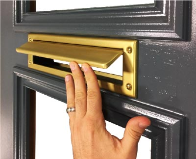 brass mail slot routed into door